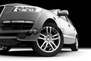 Car front bumper, light and wheel on black