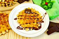 Waffles circle with chocolate and green napkin