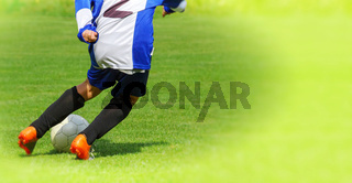 Soccer player legs dribbling in a match