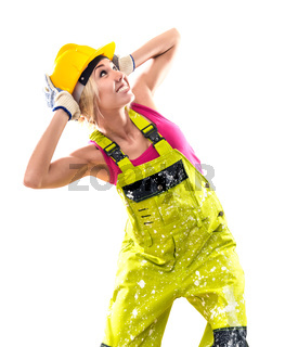 Female construction worker in coverall and hardhat posing over obsolete background