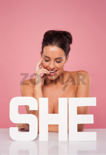 Beautiful topless woman with the word SHE