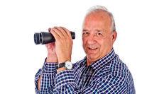 Senior with binocular