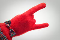 hand in red glove over grey background