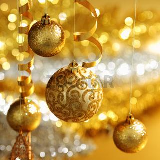 golden christmas balls on bokeh background