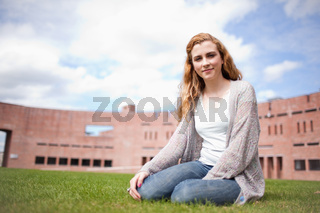 Young woman sitting on a lawn