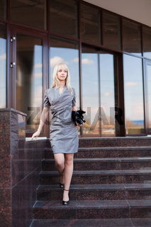 Young businesswoman on the steps