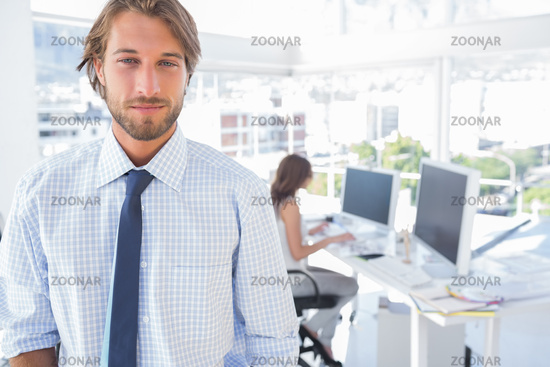 Portrait of smiling man in creative office