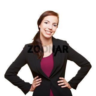 Geschäftsfrau mit Händen in der Hüfte