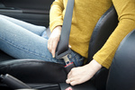 woman hand fastening a seat belt in the car