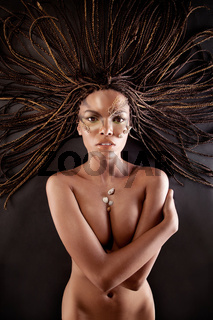 Portrait of a naked african american woman with dreadlocks