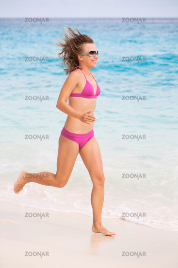 Woman Running On The Beautiful Beach