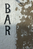 bar sign on grunge wall