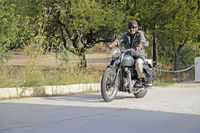 Elderly man drive on a Triumph Tiger 500 cc