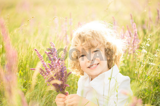 Child holding flowers