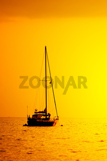 yacht silhouette in sunset light
