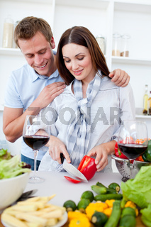 Loving couple preparing dinner