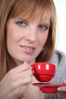 Woman with red coffee cup