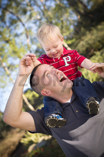 Young Laughing Father and Child Piggy Back