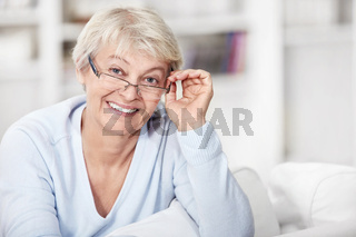 Mature woman with glasses at home