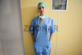 Nurse in scrubs standing in hospital room