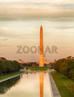 Setting sun on Washington monument reflecting