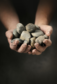 Hands full of rocks