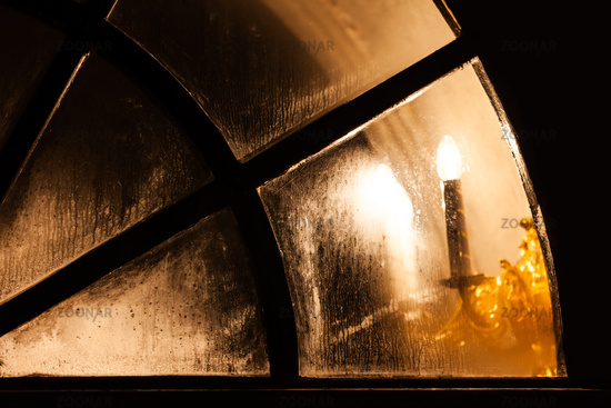 Lamp light in church window