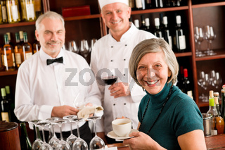 Restaurant smiling manager with staff wine bar