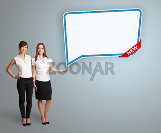 young women presenting modern speech bubble copy space