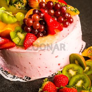Fruit cake with cream coating and fruits