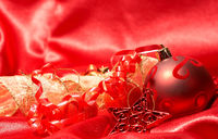 Red Christmas baubles and star