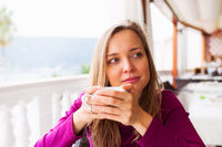 Woman tasting coffee