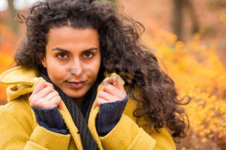 Woman portrait autumn background wind blowing hair