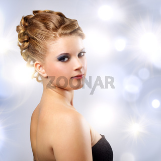 Portrait of a girl with beautiful hairstyle