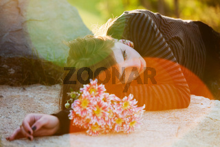 Young woman lying on the tombstone