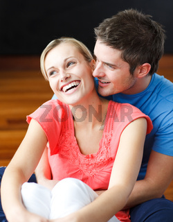 Couple sitting on the floor of their new apartment