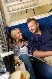 Couple smiling at each other in train