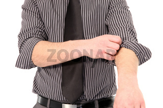 Man rolling up his shirt sleeves