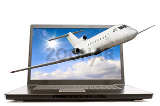 Modern notebook computer with airliner flying out
