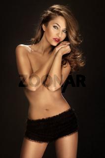 Fashion shot of beautiful sexy naked woman wearing only black panties