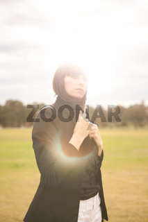 Young caucasian woman in a park with sun shining