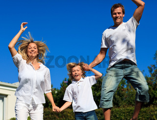 United caucasian Family Playing in the garden
