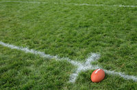 Football Near Hash Mark American Football on Natural Grass Turf