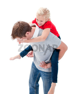 Lively father giving his daughter piggyback ride