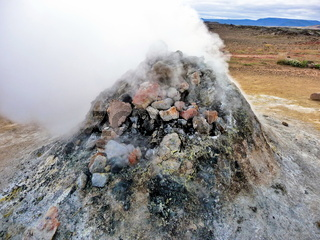 Rock pile geothermal fumarole in iceland in summer time