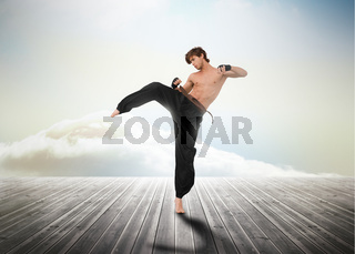Martial arts fighter over wooden boards