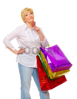 Senior woman with bags and credit card isolated