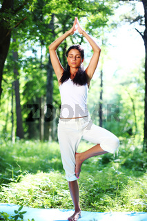 yoga woman in forest