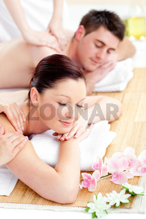 Young caucasian couple receiving a back massage