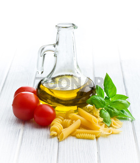 italian pasta with basil, tomatoes and olive oil
